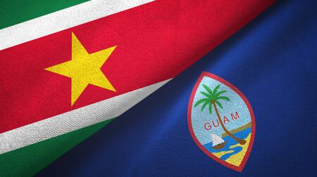 Suriname and Guam two folded flags together Zdjęcie Seryjne