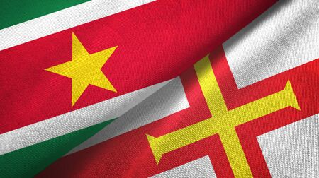 Suriname and Guernsey two folded flags together Zdjęcie Seryjne