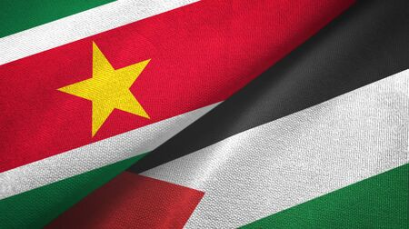 Suriname and Palestine two folded flags together 스톡 콘텐츠