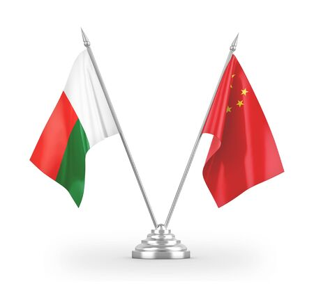 China and Madagascar table flags isolated on white background 3D rendering Фото со стока