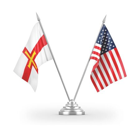United States and Guernsey table flags isolated on white background 3D rendering