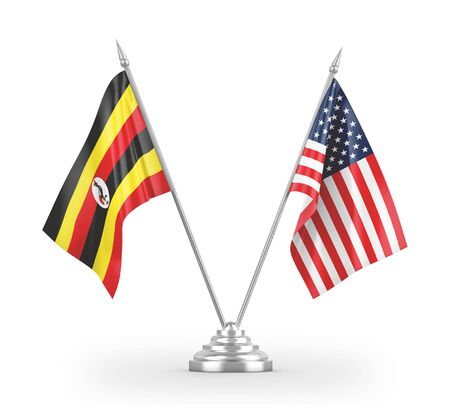 United States and Uganda table flags isolated on white background 3D rendering