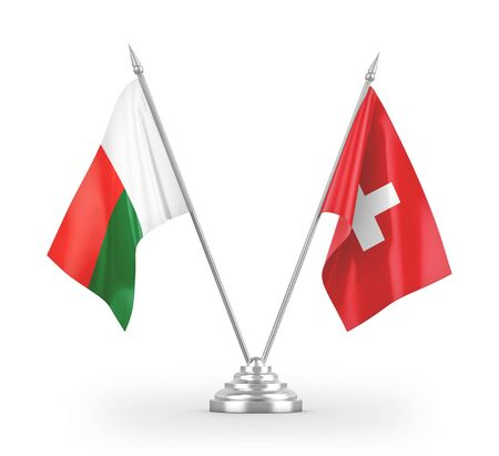 Switzerland and Madagascar table flags isolated on white background 3D rendering