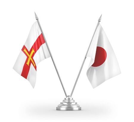 Japan and Guernsey table flags isolated on white background 3D rendering