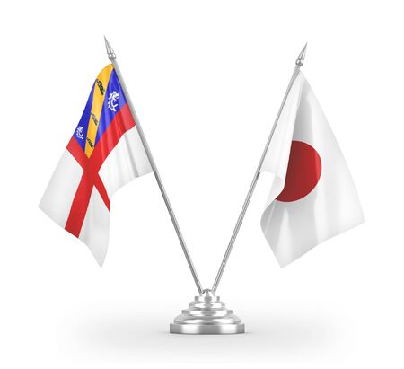 Japan and Herm table flags isolated on white background 3D rendering
