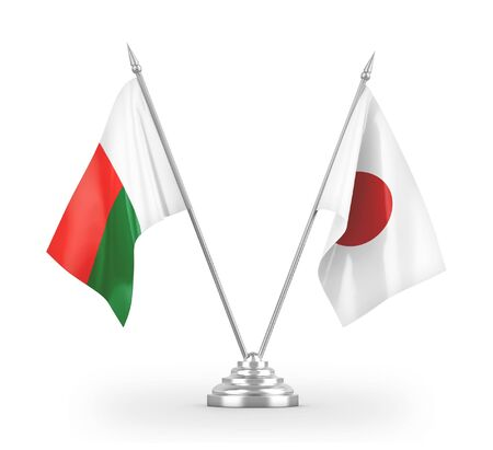 Japan and Madagascar table flags isolated on white background 3D rendering Фото со стока