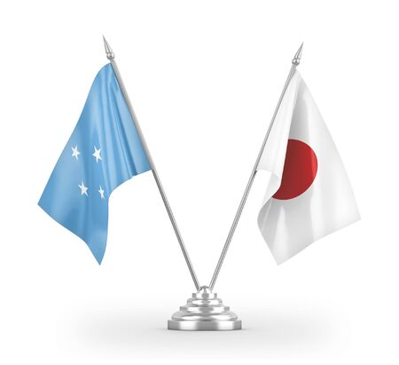 Japan and Micronesia table flags isolated on white background 3D rendering 免版税图像