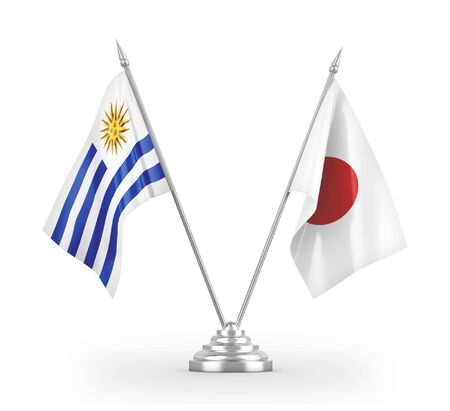 Japan and Uruguay table flags isolated on white background 3D rendering 免版税图像