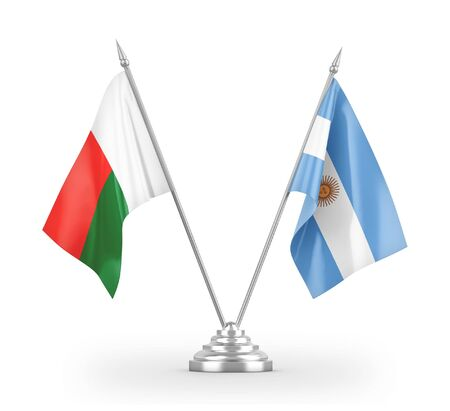 Argentina and Madagascar table flags isolated on white background 3D rendering Фото со стока