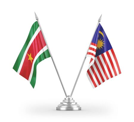 Malaysia and Suriname table flags isolated on white background 3D rendering