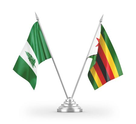 Zimbabwe and Norfolk Island table flags isolated on white background 3D rendering