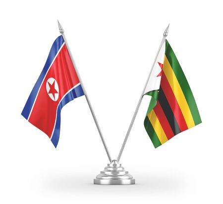 Zimbabwe and North Korea table flags isolated on white background 3D rendering Zdjęcie Seryjne