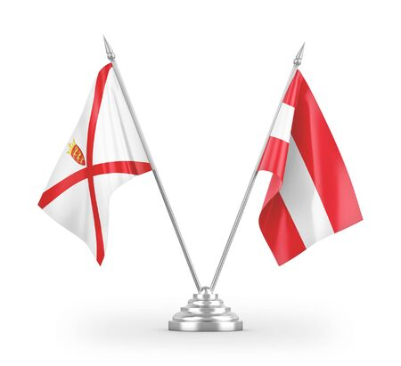 Austria and Jersey table flags isolated on white background 3D rendering