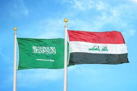 Saudi Arabia and Iraq two flags on flagpoles and blue cloudy sky background