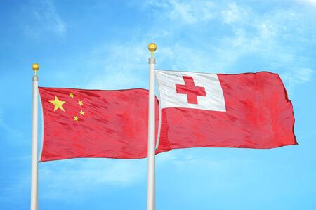 China and Tonga two flags on flagpoles and blue cloudy sky background