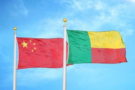 China and Benin  two flags on flagpoles and blue cloudy sky background