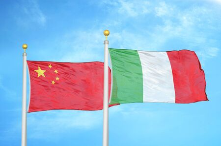 China and Italy two flags on flagpoles and blue cloudy sky background 版權商用圖片