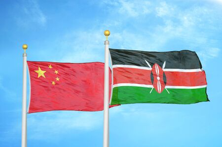 China and Kenya two flags on flagpoles and blue cloudy sky background