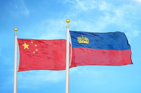 China and Liechtenstein two flags on flagpoles and blue cloudy sky background 版權商用圖片