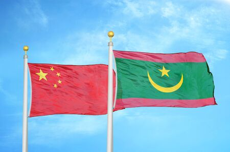 China and Mauritania two flags on flagpoles and blue cloudy sky background