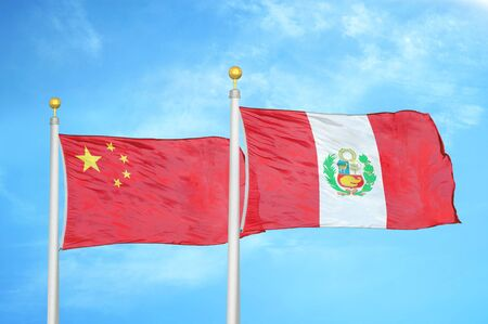China and Peru two flags on flagpoles and blue cloudy sky background