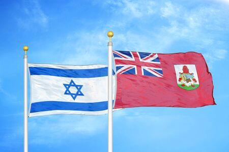 Israel and Bermuda two flags on flagpoles and blue cloudy sky background