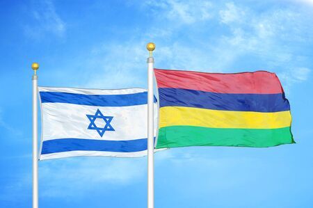 Israel and Mauritius two flags on flagpoles and blue cloudy sky background Фото со стока