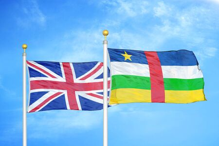 United Kingdom and Central African Republic two flags on flagpoles and blue cloudy sky background