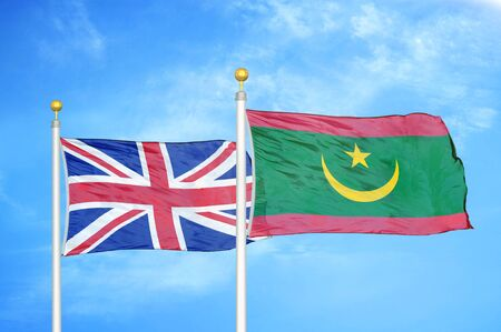 United Kingdom and Mauritania two flags on flagpoles and blue cloudy sky background