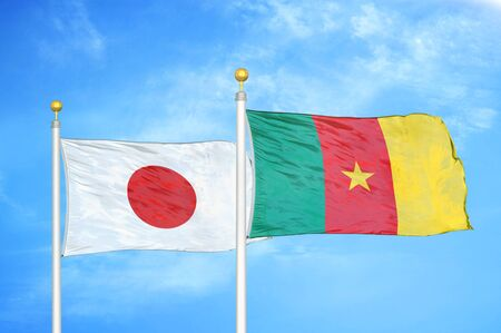 Japan and Cameroon  two flags on flagpoles and blue cloudy sky background