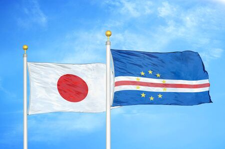 Japan and Cape Cabo Verde  two flags on flagpoles and blue cloudy sky background