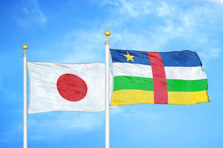 Japan and Central African Republic two flags on flagpoles and blue cloudy sky background