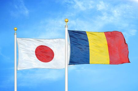 Japan and Chad  two flags on flagpoles and blue cloudy sky background