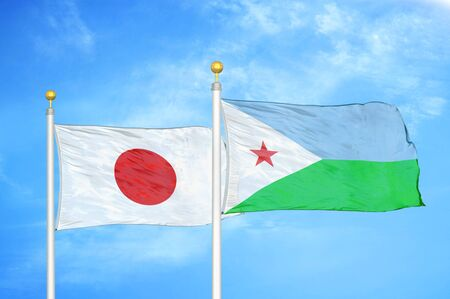 Japan and Djibouti two flags on flagpoles and blue cloudy sky background