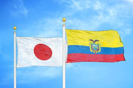 Japan and Ecuador two flags on flagpoles and blue cloudy sky background