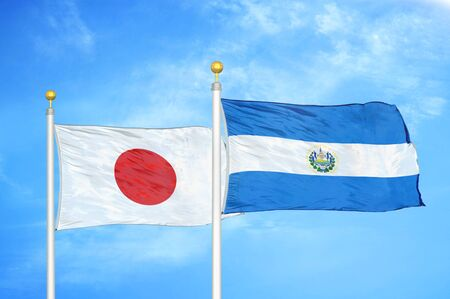 Japan and El Salvador two flags on flagpoles and blue cloudy sky background