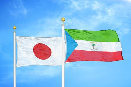 Japan and Equatorial Guinea two flags on flagpoles and blue cloudy sky background Фото со стока