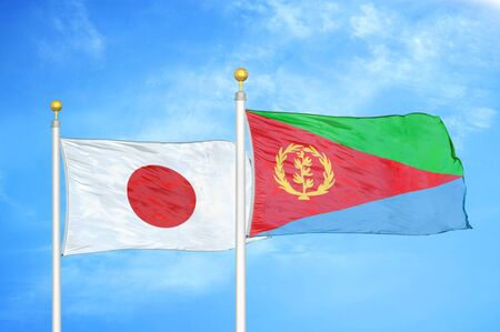 Japan and Eritrea two flags on flagpoles and blue cloudy sky background Фото со стока