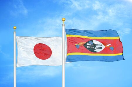 Japan and Eswatini Swaziland  two flags on flagpoles and blue cloudy sky background