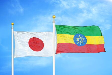 Japan and Ethiopia two flags on flagpoles and blue cloudy sky background