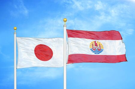 Japan and French Polynesia two flags on flagpoles and blue cloudy sky background