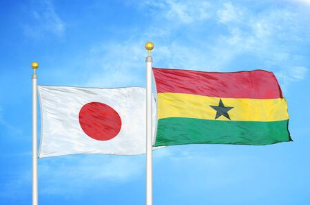 Japan and Ghana two flags on flagpoles and blue cloudy sky background Фото со стока