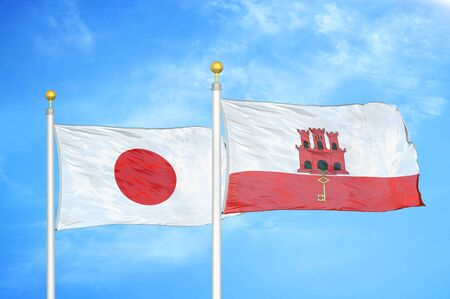 Japan and Gibraltar two flags on flagpoles and blue cloudy sky background