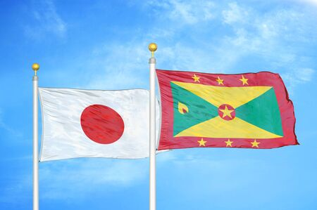 Japan and Grenada two flags on flagpoles and blue cloudy sky background Фото со стока