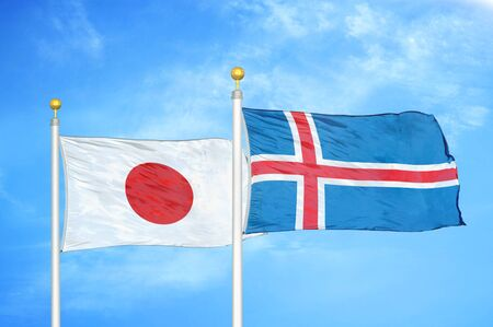 Japan and Iceland two flags on flagpoles and blue cloudy sky background