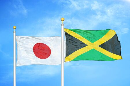 Japan and Jamaica two flags on flagpoles and blue cloudy sky background Фото со стока