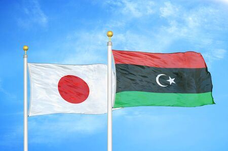 Japan and Libya two flags on flagpoles and blue cloudy sky background 스톡 콘텐츠