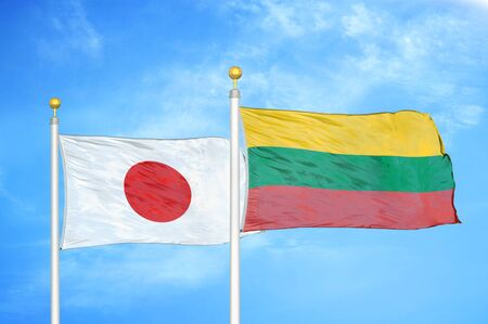 Japan and Lithuania two flags on flagpoles and blue cloudy sky background