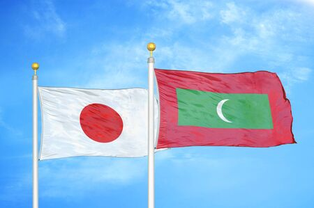 Japan and Maldives two flags on flagpoles and blue cloudy sky background