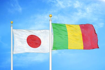 Japan and Mali two flags on flagpoles and blue cloudy sky background